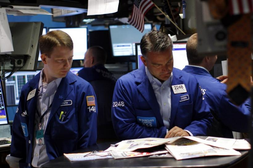 Traders work on the main trading floor of the New York Stock Exchange in New York