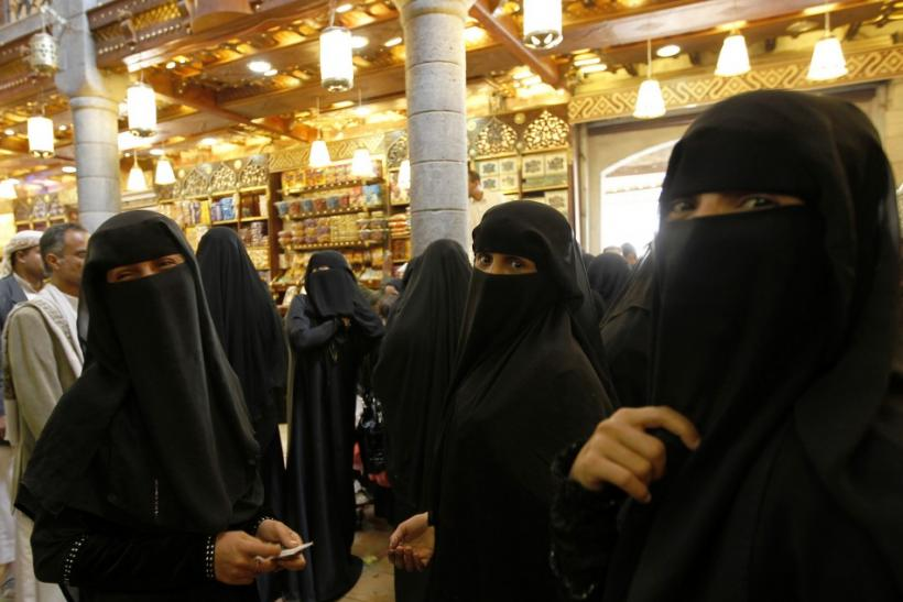 Women stand in line at the check out counter at a supermarket in preparation for the Muslim holy month of Ramadan, in the Old City of Sanaa, Yemen