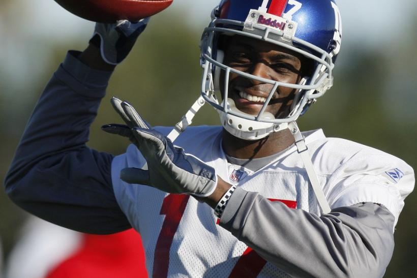 New York Giants wide receiver Plaxico Burress throws during practice for their upcoming National Football League (NFL) Super Bowl game against the New England Patriots in Tempe
