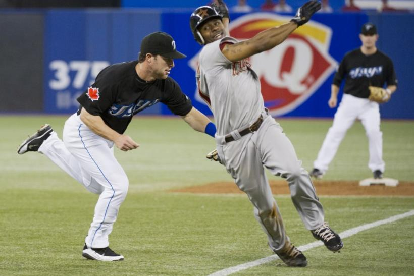Blue Jays third baseman Nix tags Bourn out at third base during their Interleague MLB baseball game in Toronto