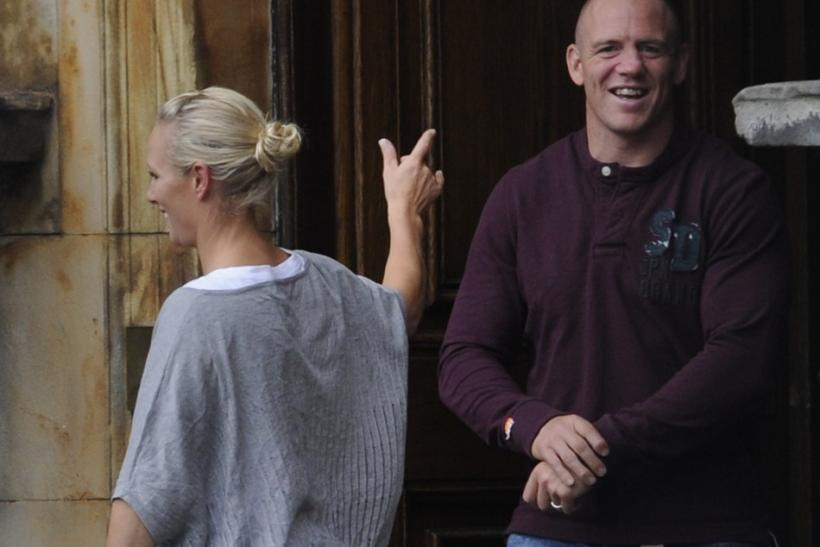 Britain's Zara Phillips, the eldest granddaughter of Queen Elizabeth and her new husband England rugby captain Mike Tindall leave Holyrood Palace in Edinburgh, Scotland