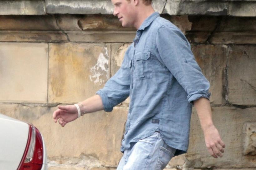 Britain's Prince Harry walks to a car outside Holyrood Palace after the marriage on Saturday between Britain's Zara Phillips, the eldest granddaughter of Queen Elizabeth, and England rugby captain Mike Tindall, in Edinburgh, Scotland July 31, 2011.