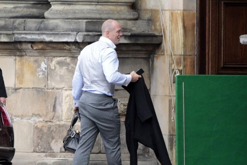 England rugby captain Mike Tindall walks into Holyrood Palace, after his marriage on Saturday to Britain's Zara Phillips, the eldest granddaughter of Queen Elizabeth, in Edinburgh, Scotland