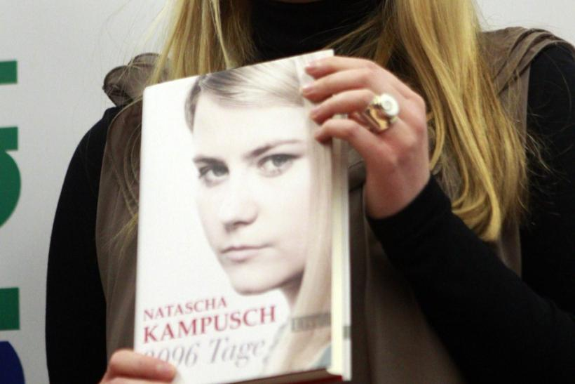 Austrian kidnap victim Natascha Kampusch poses with her book 3,096 Days during a photo call in a bookstore in Vienna