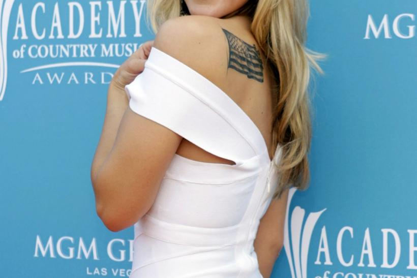 Singer Duncan shows off her U.S. flag tattoo at the 45th annual Academy of Country Music Awards in Las Vegas