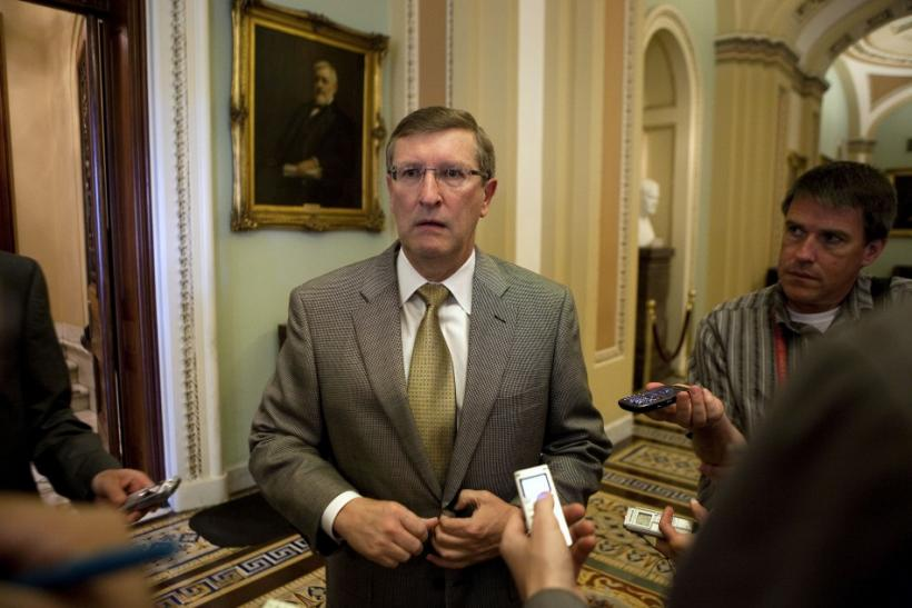 Senator Conrad speaks to reporters as he walks to the Senate chamber on Capitol Hill in Washington