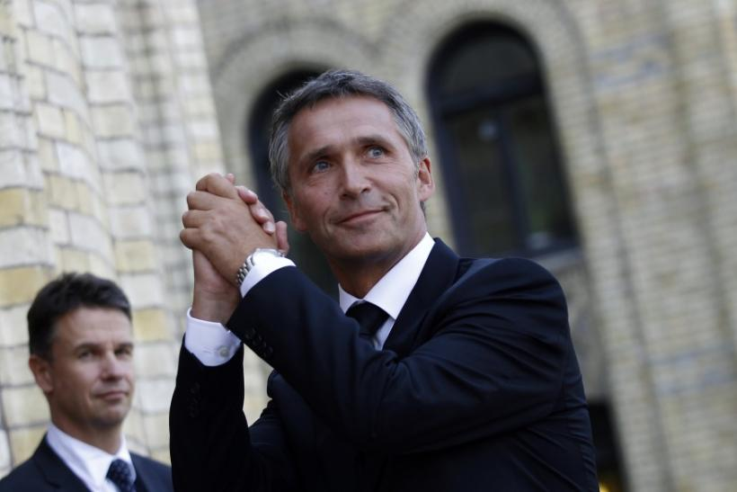 Norway's Prime Minister Stoltenberg gestures to supporters outside the Storting in Oslo
