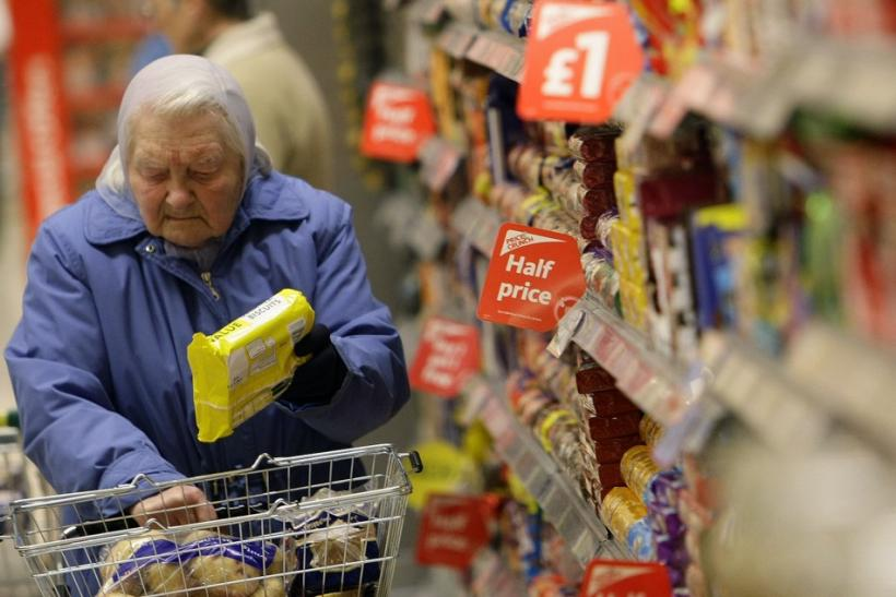 An elderly customer shops at a Morrisons store in Welling, Southeast London.