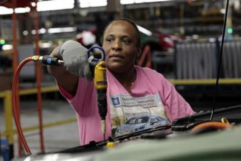 United Auto Workers union member assembly worker Ingrid Hill works on a Chevrolet Volt electric vehicle at General Motors' Detroit-Hamtramck assembly plant