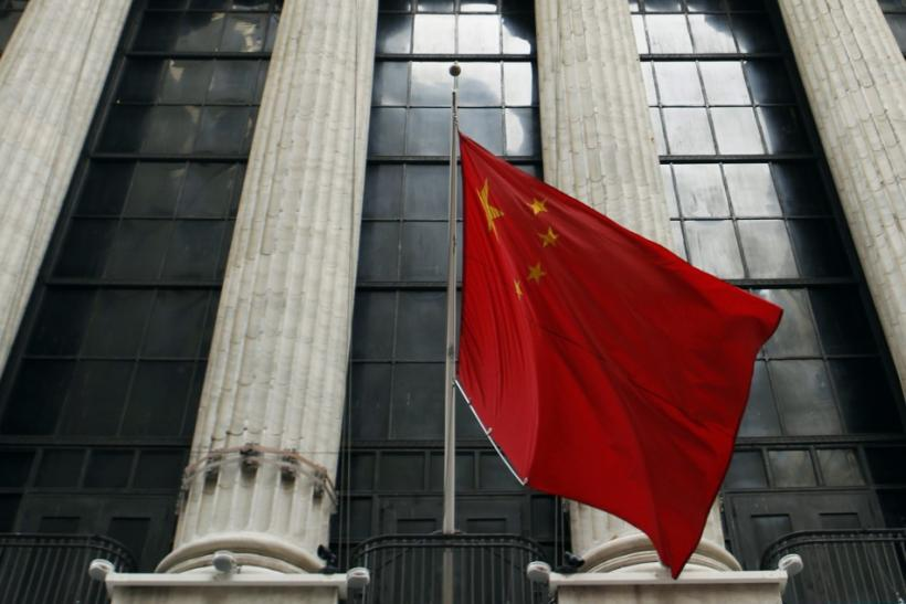 A Chinese flag hangs outside of the New York Stock Exchange