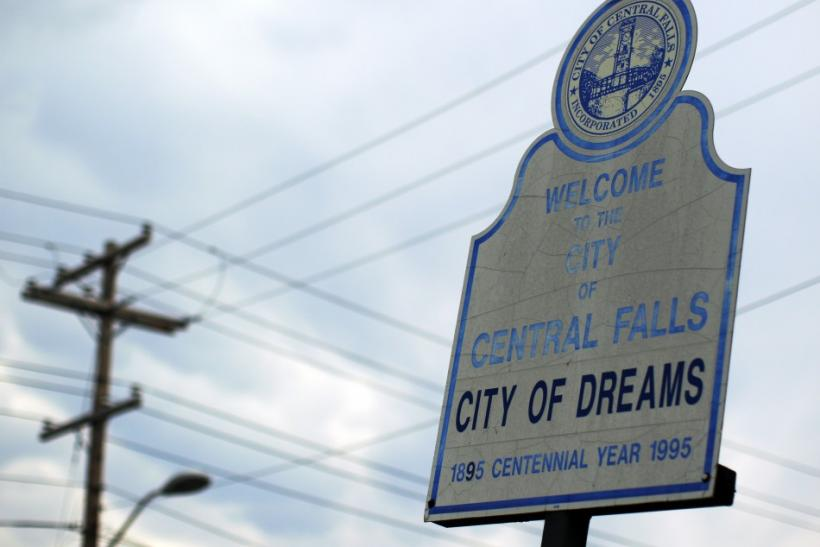 "A sign calling Central Falls, Rhode Island a ""City of Dreams"" marks the town's boundary on Higginson Avenue"