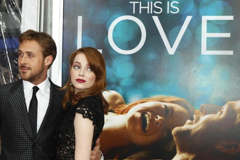 Cast members Ryan Gosling (L) and Emma Stone arrive for the premiere of their film 'Crazy, Stupid, Love' in New York