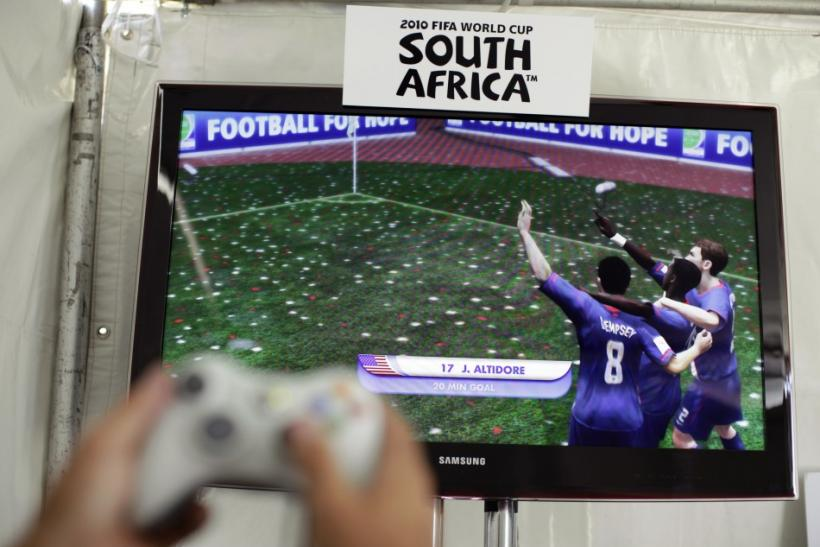 A person plays the EA Sports 2010 FIFA World Cup South Africa video game in Los Angeles