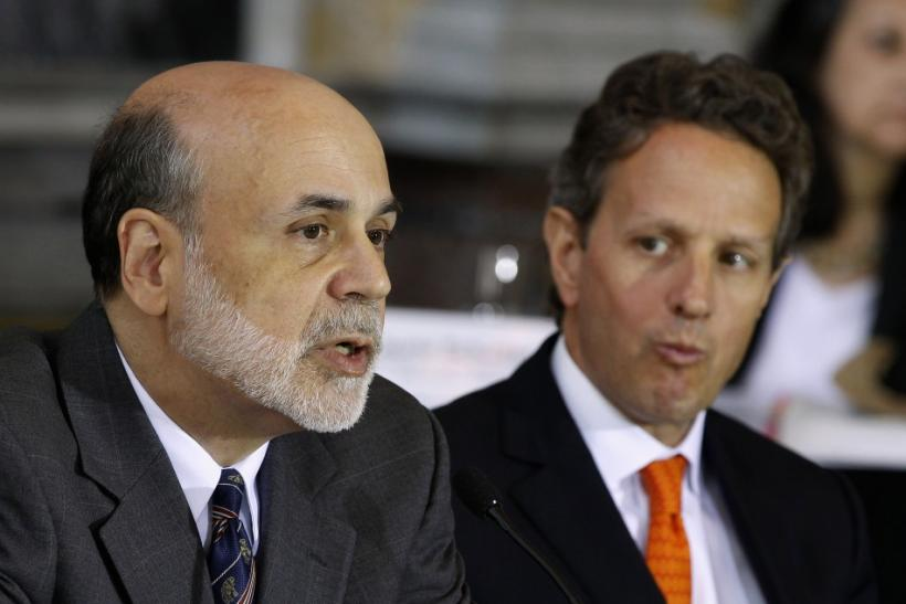 U.S. Treasury Secretary Geithner listens to Chairman of the Federal Reserve Bernanke in Washington