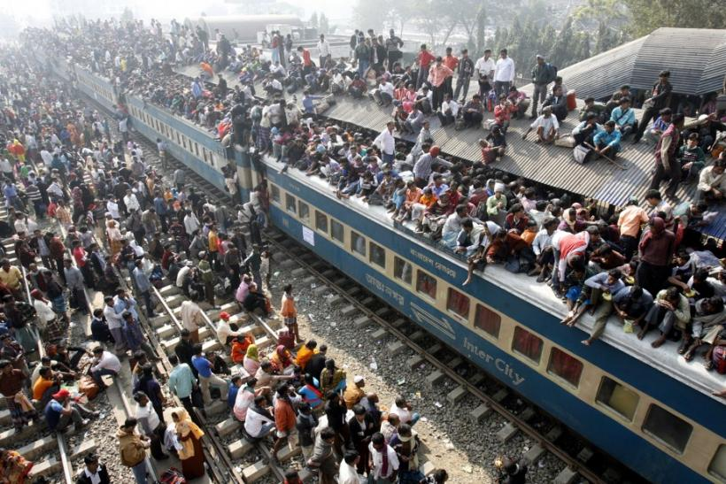 An overcrowded train leaves Dhaka's Airport rail station ahead of the Muslim festival Eid-al-Adha