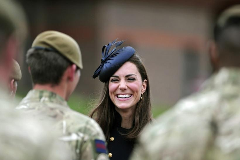 Britain's Catherine, Duchess of Cambridge speaks with soldiers during a medal ceremony for the Irish Guards at the Victoria Barracks in Windsor