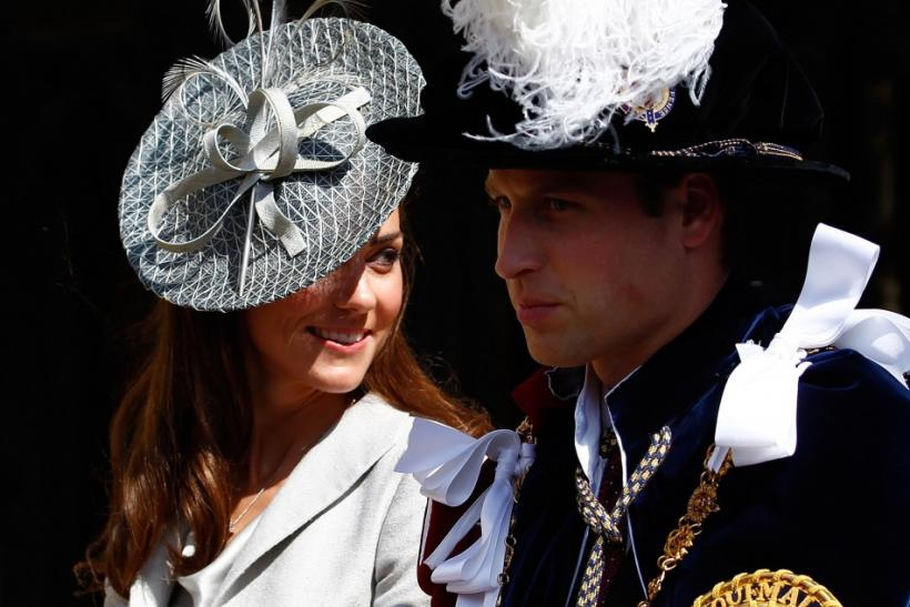 Britain's Catherine, Duchess of Cambridge (L), sits next to her husband Prince William as they leave the Order of the Garter service at St. George's chapel inside the grounds of Windsor Castle, in Windsor, southern England