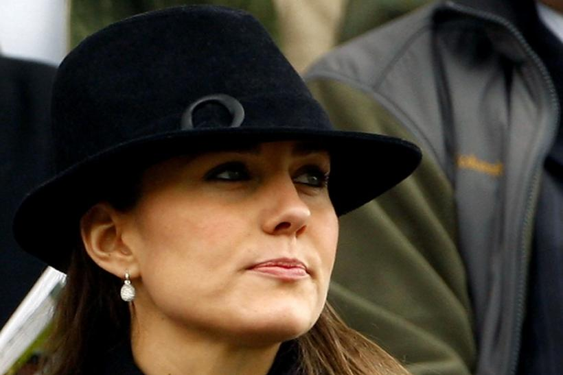 Middleton watches the first race at the Cheltenham Festival horse racing meeting
