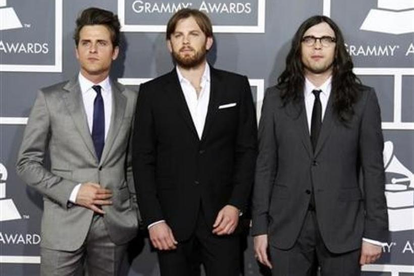 Rock band Kings of Leon pose on arrival at the 53rd annual Grammy Awards