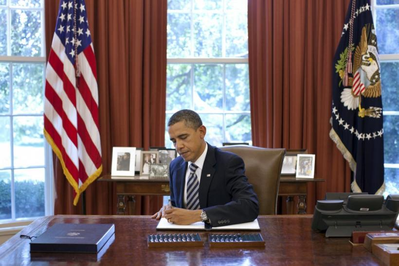 U.S. President Barack Obama signs the Budget Control Act of 2011 in the Oval Office at the White House in Washington