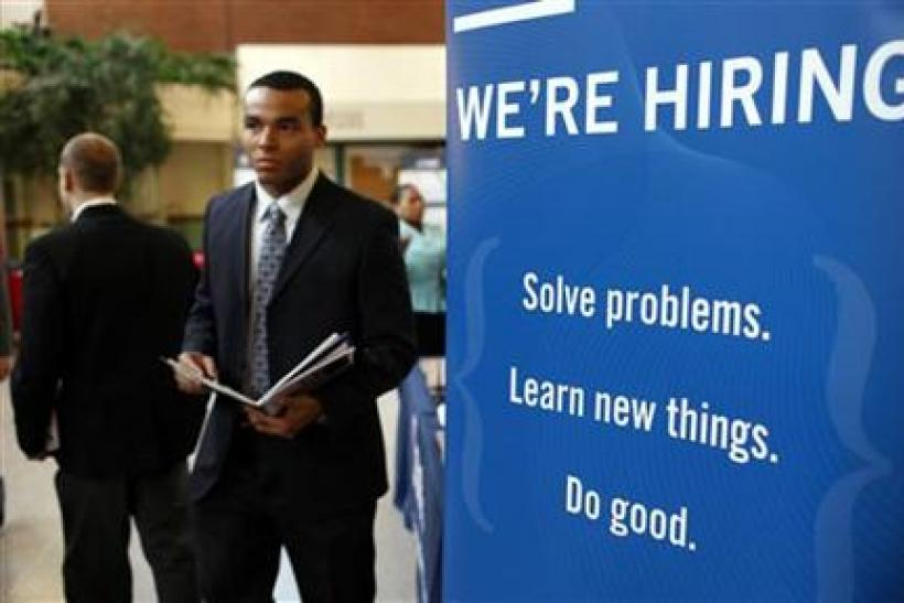 A job seeker walks the floor at a large career fair at Rutgers University in New Brunswick
