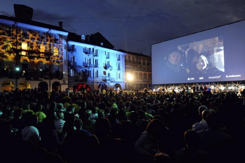 People watch a film at the Piazza Grande on the opening evening of the 64th Locarno Film Festival