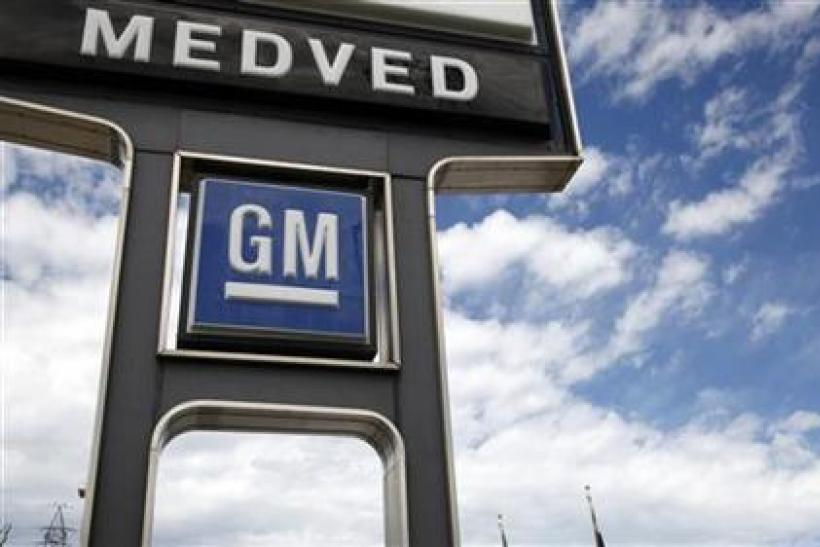 A GM sign is seen outside the Medved General Motors car dealership in Arvada, Colorado