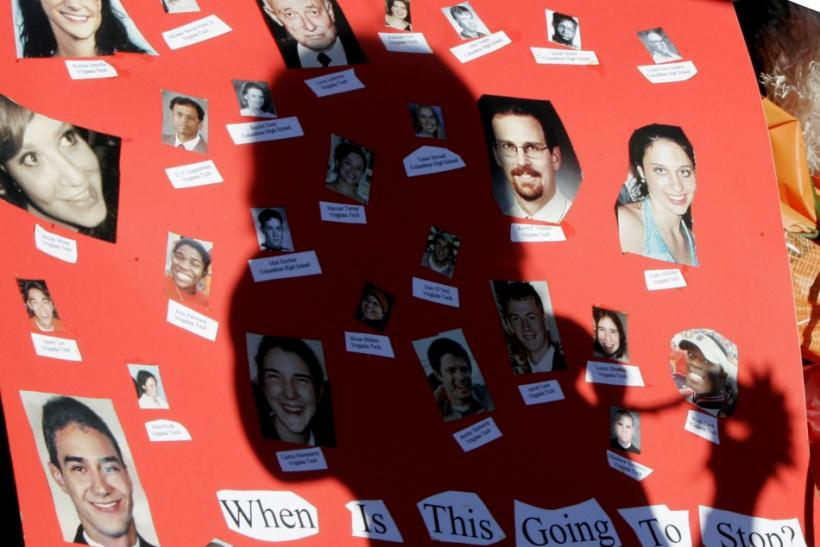 Poster with photos of the victims