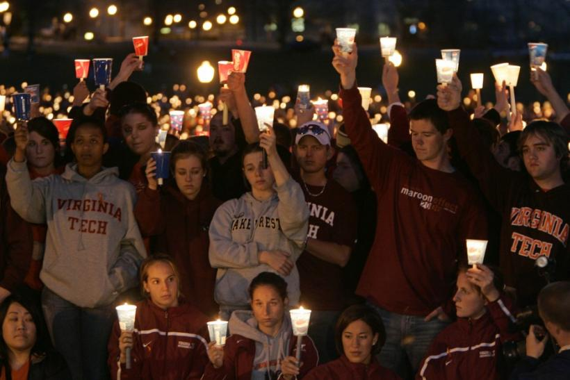Mourners grieve at a candlelight vigil for the victims of the Virginia Tech shootings in Blacksburg