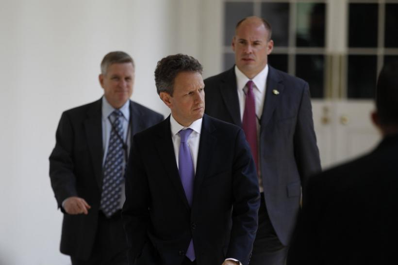 U.S. Treasury Secretary Timothy Geithner walks to the Rose Garden