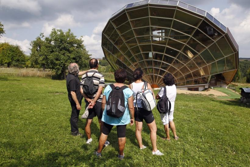 Visitors look at the Heliodome, a bioclimatic solar house build in Cosswiller in the Alsacian countryside near Strasbourg, Eastern France