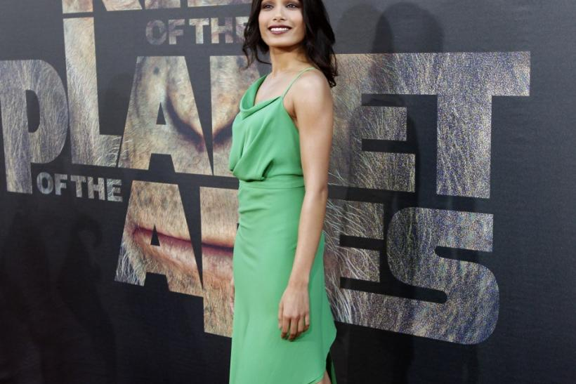 "Pinto poses at the premiere of ""Rise of the Planet of the Apes"" at the Grauman's Chinese theatre in Hollywood"