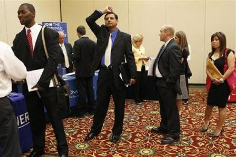 People wait in line to meet a job recruiter at a job fair in Melville, New York