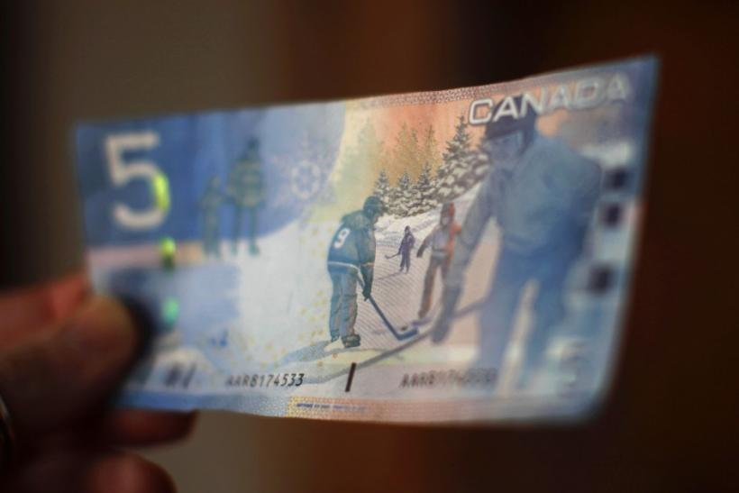 A Canadian five-dollar bill is seen in a posed photograph in Montreal.