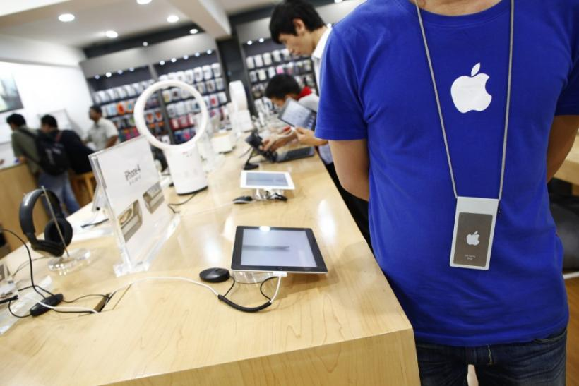 An employee stands inside a fake Apple Store in Kunming, Yunnan province July 22, 2011.