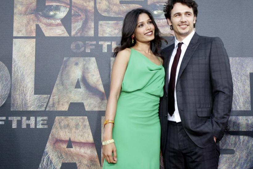 "Franco and Pinto pose at the premiere of ""Rise of the Planet of the Apes"" at the Grauman's Chinese theatre in Hollywood"