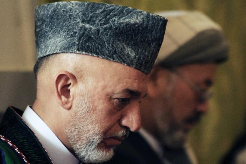 Afghanistan's President Karzai attends the funeral ceremony for his brother Karzai at presidential palace in Kabul