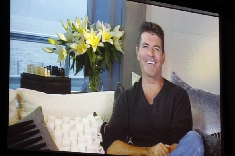 Simon Cowell, one of the judges on new reality series 'The X Factor', speaks via satellite at the FOX Summer TCA Press Tour in Beverly Hills