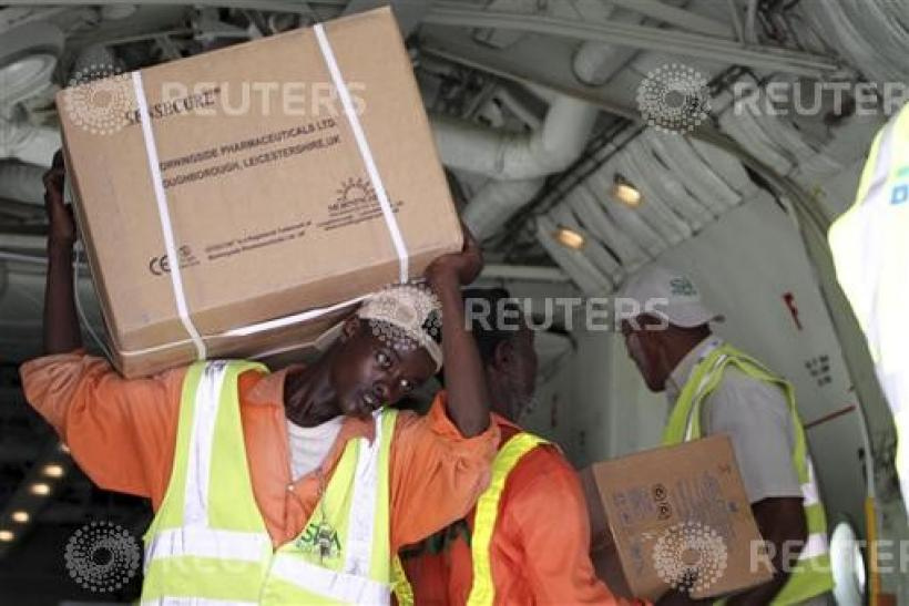Airport workers offload medical supplies from Kuwaiti airplane as part of humanitarian support for the internally displaced people in Somalia's capital Mogadishu