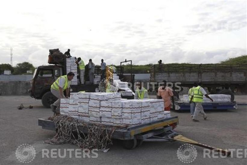 Some of the 10 tonnes of relief food from the World Food Programme (WFP) is loaded onto a truck at Mogadishu airport