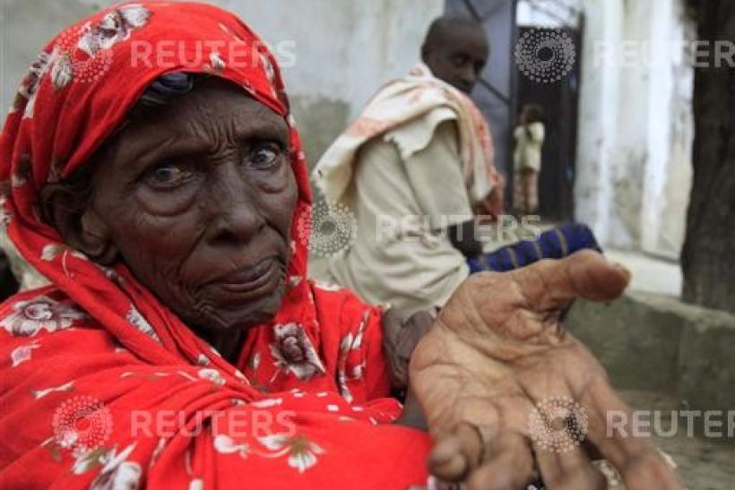 An internally displaced Somali woman begs for assistance outside her shelter in Mogadishu