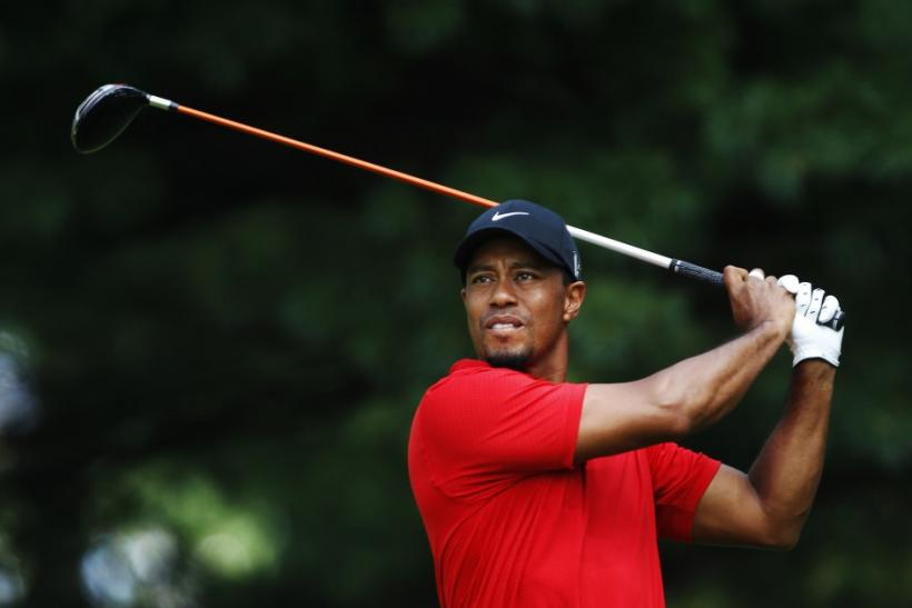 Tiger Woods of the U.S. tees off on the second hole during the final round of the WGC Bridgestone Invitational PGA golf tournament at Firestone Country Club in Akron