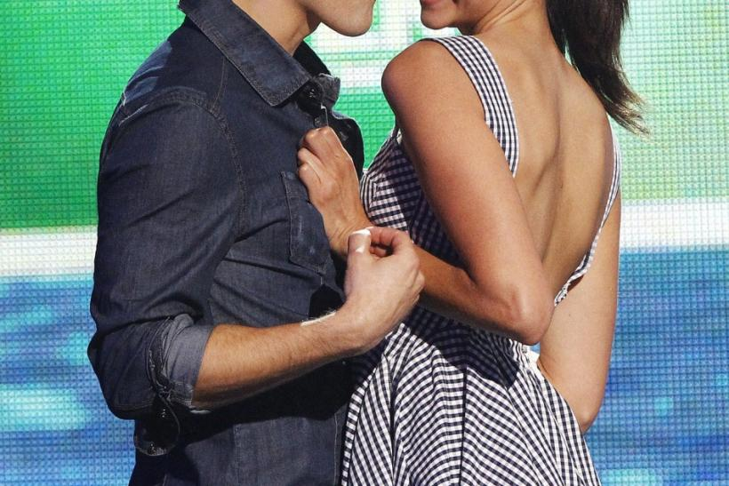 Actors Paul Wesley and Nina Dobrev present the Choice Movie Actor: Romantic Comedy award at the Teen Choice Awards at the Gibson amphitheater in Universal City, California