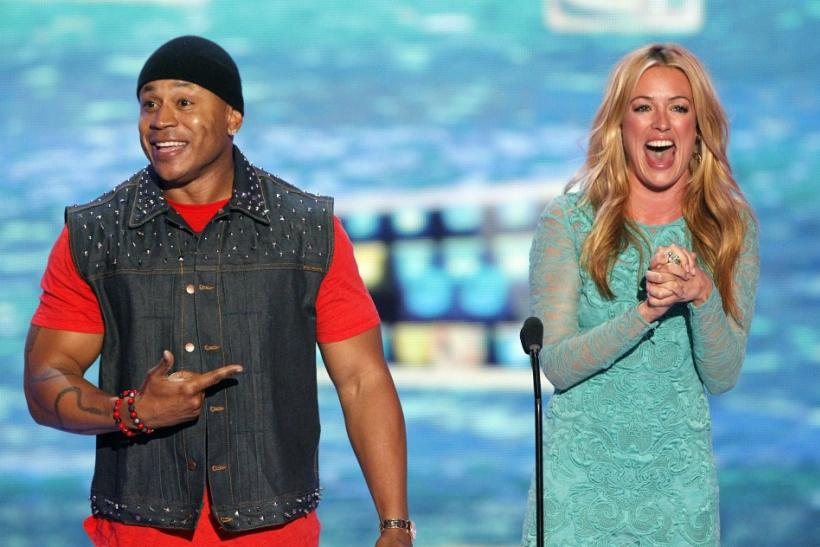 Singer LL Cool J and actress Cat Deeley speak on stage at the Teen Choice Awards at the Gibson amphitheater in Universal City, California