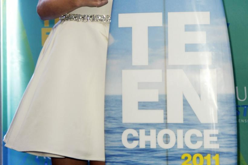 Actress Taylor Swift poses in the press room with her award backstage at the Teen Choice Awards in Los Angeles