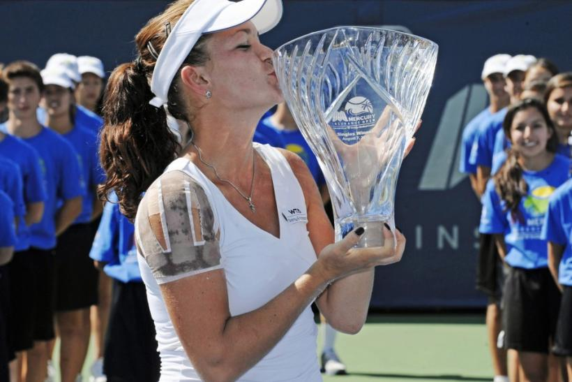 Radwanska of Poland kisses the trophy after winning her final match against Zvonareva of Russia at a WTA tennis event in Carlsbad