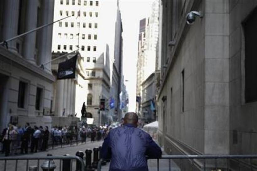 A trader stands outside the New York Stock Exchange following the end of the trading day