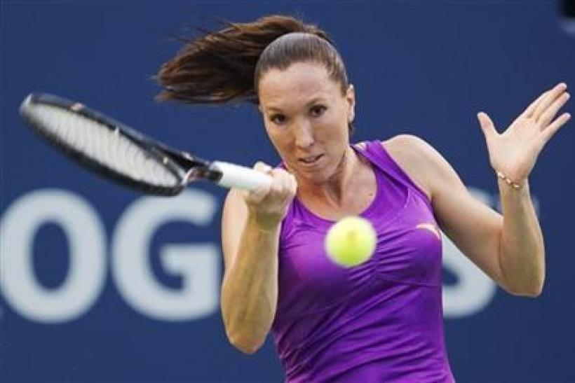Jelena Jankovic of Serbia returns a shot to Julia Goerges of Germany during their match at the Rogers Cup women's tennis tournament in Toronto