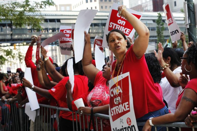 Workers rally outside Verizon headquarters in New York