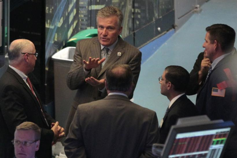 Duncan Niederauer, (top C) CEO of NYSE Euronext, speaks to traders and staff on the floor of the New York Stock Exchange